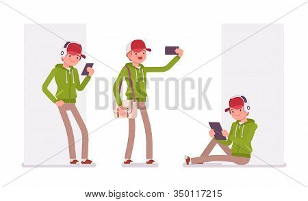 Young Man Wearing A Hoodie With Gadgets. Cute Smart Guy In A Casual Hoody With Smartphone, Taking Se