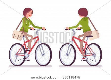 Young Woman Wearing A Hoodie Riding A Bike. Cute Lady In A Casual Hoody Cycling, Traveling By Bicycl