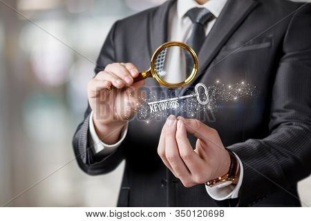 The Concept Of Keyword Search.a Man Looks At Keywords Through A Magnifying Glass.