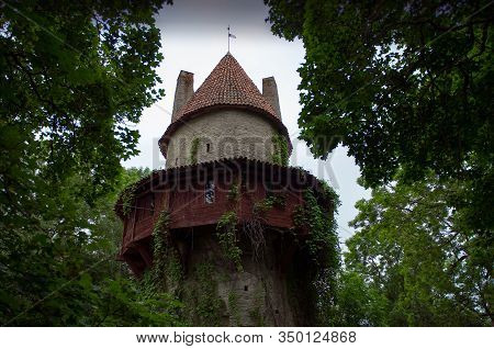 Old Castle Citadel Tower With Red Roof Behind The Green Trees. Kiiu Vassal Stronghold, Or The Kiiu T