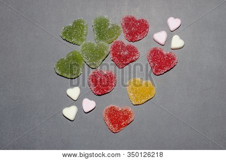 Set Of Heart Shaped Jelly Candies Isolated On Gray Background. Top View, Soft Selective Focus. Color