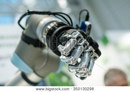 Robotic cyborg automated hand made with steel and black plastic as part of machine tool