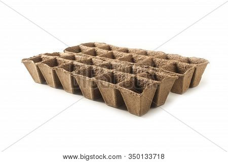 Peat Forms For Growing Seedlings Isolated On A White Background
