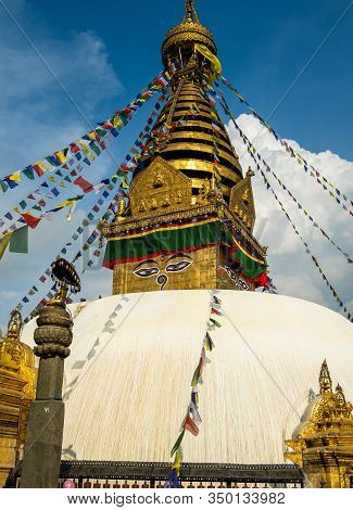 The Upper Part Of The Stupa In Buddhist Temple Swayambhunath In Kathmandu. The Image Of Buddhas Eyes