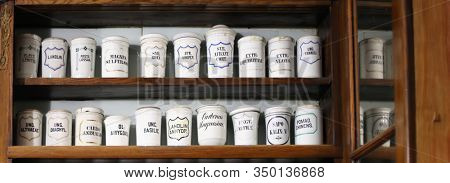 Wooden shelf with medicines in an old pharmacy.