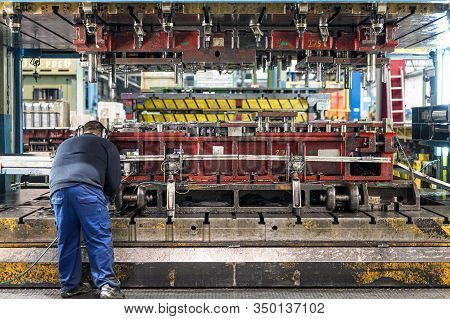 The Hydraulic Bending Machine Operation By Technical Operator. Sheet Metal Manufacturing Process By