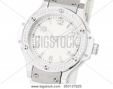 Face Wristwatch Decorated With Rhinestones Made Of Precious Stones On A Silver Case With A Light Dia