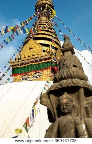 The Upper Part Of The Stupa In Buddhist Temple Swayambhunath In Kathmandu Against The Background Of