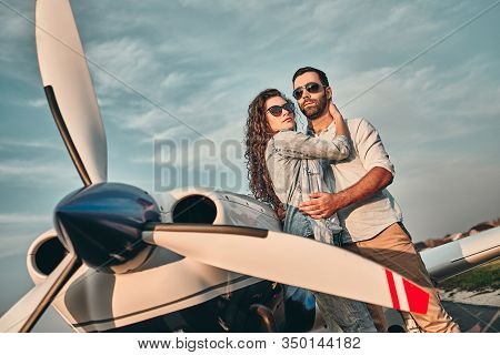 Couple Of Lovers Taking A Charter Airplane.