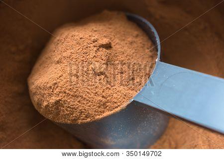 Spoon Picking Chocolate Flavor Whey Protein Powder