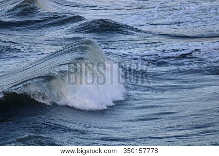 Pacific Wave Rises To Meet The Shore.