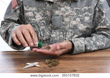 Military Drug abuse concept. Closeup of soldier with medical marijuana to treat his PTSD symptoms.