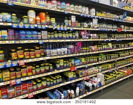 Orlando,fl/usa -2/6/20:  The Vitamin And Supplement Aisle Of A Walmart Superstore With A Variety Of