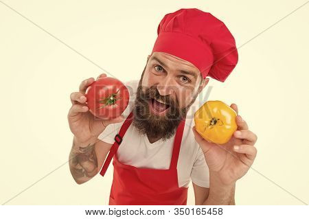 Jump To Diet. Happy Bearded Cook Hold Tomatoes. Professional Chef Cook Vegetarian Food. Cooking Vita