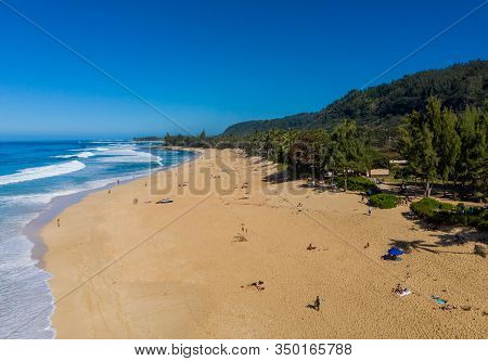 Locals And Tourists On The Sand Beach At Banzai Pipeline On North Coast Of Oahu, Hawaii