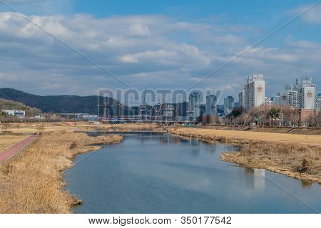 Daejeon, South Korea; January 30, 2020: Cityscape Of River Park In Yuseoung-gu Under Cloudy Blue Sky