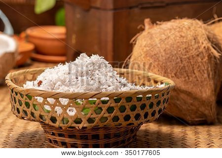 Coconut Powder Of A Coconut In Basket On Table Inside Kitchen For Making Coconut Milk