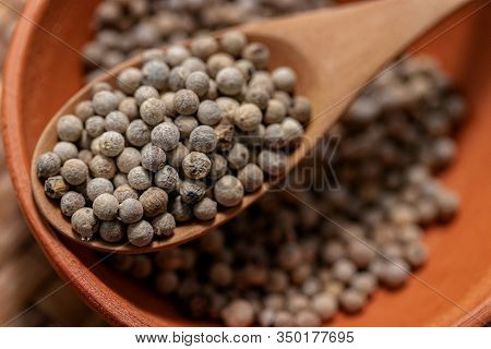 Close-up Of White Pepper On Wooden Spoon, Most Important Flavorings In East Asia.