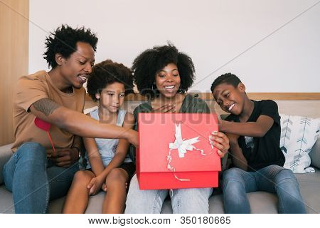 Father And Children Congratulate Mother On Mother's Day.