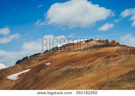 Awesome Vivid Stony Hill With Snow In Sunlight. Colorful Sunny Highland Landscape With Mountain With