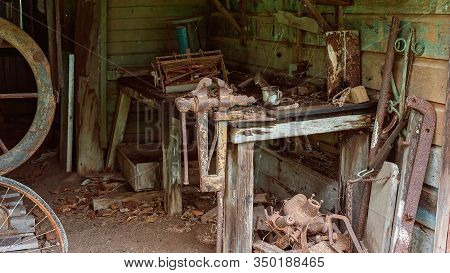 Old Rusted Machine Implements Which Would Have Been Used By Early Settler Farmers Of Yesteryear