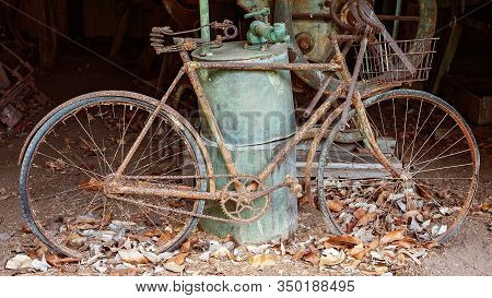 An Ancient Rusted Bicycle Used By Early Settlers, Now Housed In An Old Country Shed