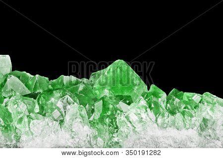 macro photo of green emerald druse isolated on black background