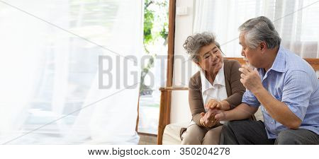 Asian Senior Retired Couple Holding Hands And Take Care Together At Home, Alzheimer Disease Or Suffe
