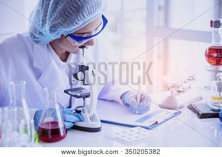 Female Scientist Look At Microscope, Science Test Tube Analyse Scientific Sample In Laboratory Resea