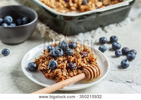 Baked Oatmeal With Blueberries And Honey In On A White Plate. Oatmeal Fruit Crumble Pie.