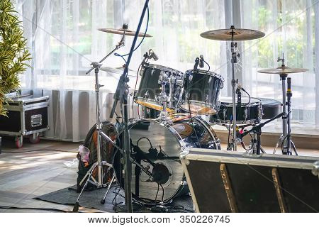 Drum Set In A Cafe Or Restaurant Before A Corporate Party Or Wedding On The Background Of A Large Wi