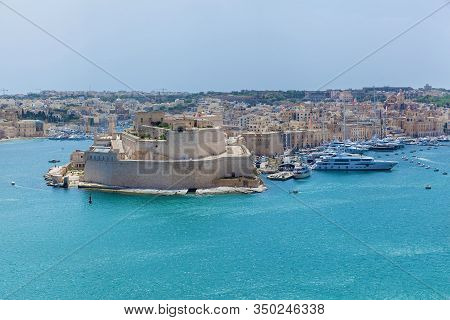 View Of Vittoriosa Harbor And The Battery Of Medieval Cannons From The Wall Of Valletta. Salyutovaya