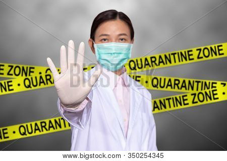 Asian Female Doctor Wear A Medical Mask, Raise Hand For Stop Sign To Do Not Enter Quarantine Area Wi