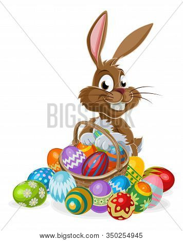 Easter Bunny Rabbit Cartoon Character Holding An Easter Eggs Basket Full Of Eggs, Could Be On A Choc