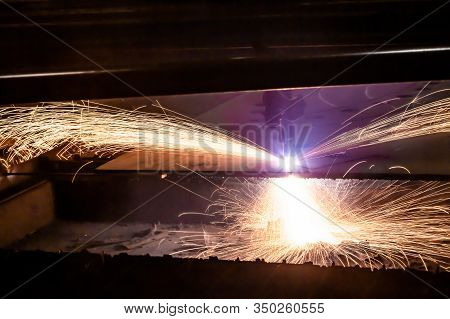 Plasma Cutting Of Metal With A Cnc. Plasma Cutting Machine Cutting Steel Sheet. Laser Cutter In Prod