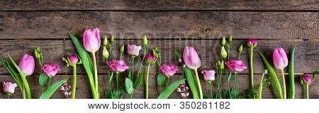 Pink Tulips On Old Rustic Wood. Fresh Spring Flowers Decorated In A Row For Mothersday. Wide Photogr