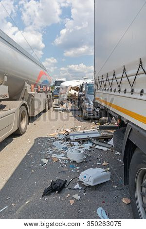 Semi Trucks And Camper Trailer Traffic Accident At Highway
