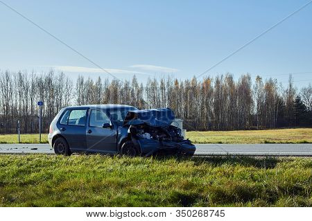 Damaged Car On Road Side On Sunny Day