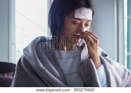 Asian Women Have High Fever And Runny Nose. Sick People Concept