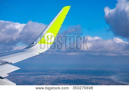 Tokyo, Japan - Jan 19, 2020: The Wing Of The S7 Airline Plane From The Window Over Tokyo. View Of Th