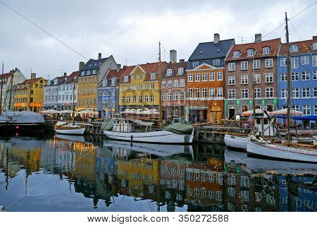 Copenhagen, Denmark - January 16, 2020 : Colourful Houses And Restaurants On Nyhavn Canal With Old S