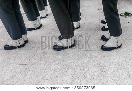 Close Up View Of Turkish Soldiers Trousers, Boots And Gaiters In Line For A Funeral.