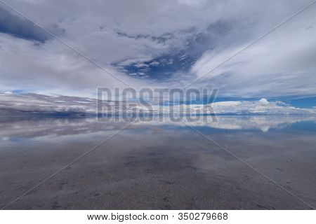The Salar De Uyuni Flooded After The Rains, Bolivia. Clouds Reflected In The Water Of The Salar De U