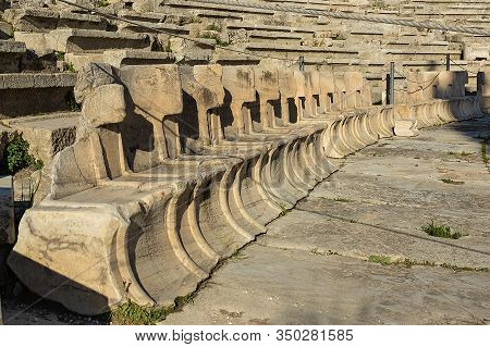 Dionysus Theater In The Acropolis. View Of A Row Of Marble Seats In The Ruins Of An Amphitheater