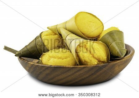 Pile Of Toddy Palm Cake Or Kanom Tarn, The Local Thai Dessert In Wooden Bowl On White Background Wit