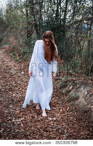 Outdoor Portrait Of Beautiful Girl In White Nightgown, Walking Barefoot. Retro Vibes