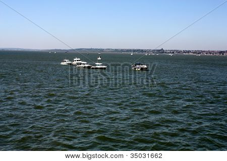 boats moored on the sea