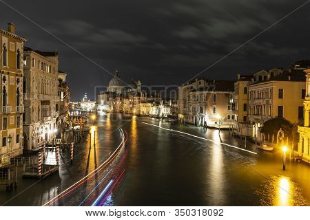 View From The Accademia Bridge Towards San Giorgio Island Venice, Italy. Night Photography With Mult