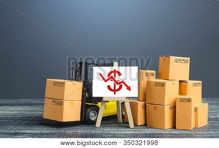 Forklift Near Boxes And Easel With Red Dollar Arrow Down. Decline Trade And Production Rates, Decrea