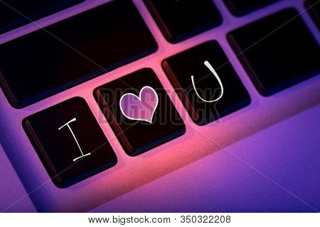 I love you message on the keyboard key of a laptop, mystery declaration of love, creative romantic idea, Valentine's day background